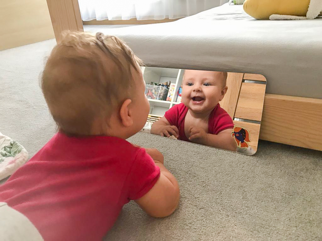 Child looking in a mirror