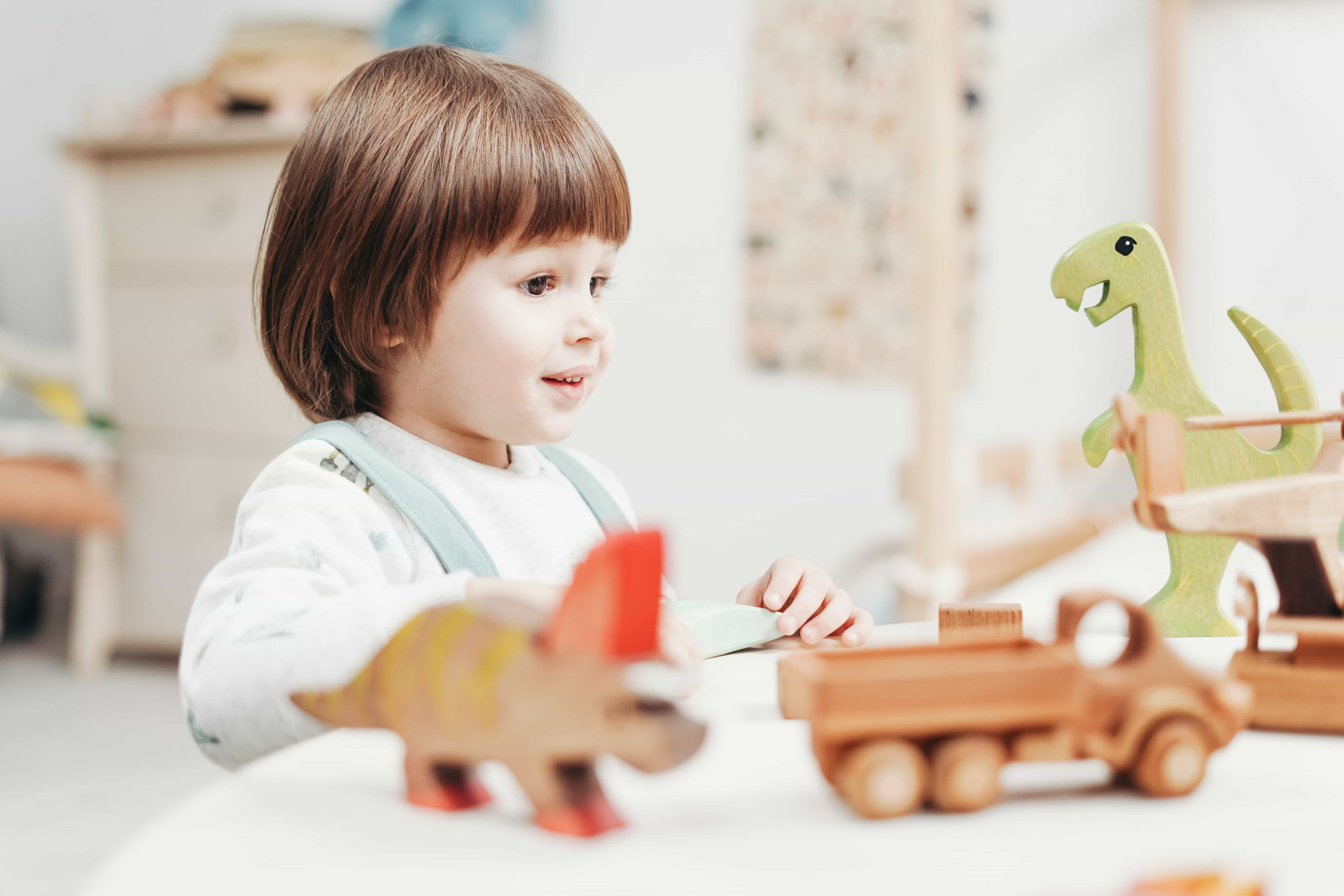Child playing with dinosaurs-1